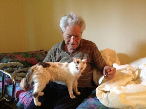 Hubert P. Yockey with an elderly calico cat named Cleo.